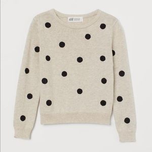 Kids sweater. Beige and black